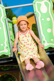 Girl and jungle gym Royalty Free Stock Image