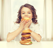 Girl with junk food Royalty Free Stock Images