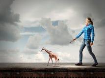 Girl with kangaroo Stock Images