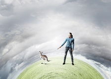Girl with kangaroo Stock Photography
