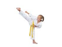 Girl in karategi beats kick Yoko geri Stock Photos