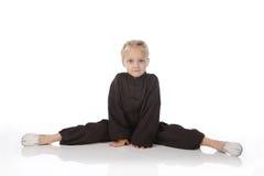 Girl - karateka in a black kimono Royalty Free Stock Photos