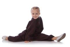 Girl - karateka in a black kimono Royalty Free Stock Photo