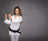 Girl with katana and black belt stock images