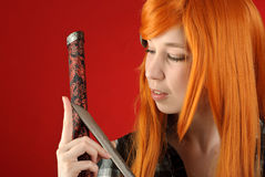 Girl with katana sword Royalty Free Stock Image