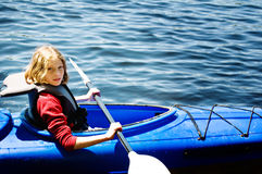 Girl in a kayak. Tween aged girl in a kayak Royalty Free Stock Photography