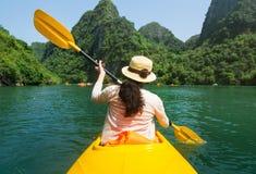 Girl kayaking on seaside of Halong bay in Vietnam Royalty Free Stock Photo