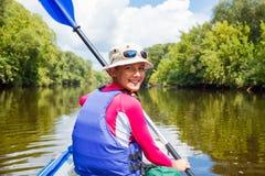 Girl kayaking Stock Image