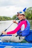 Girl kayaking Stock Photography