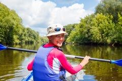 Girl kayaking Stock Images
