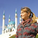 Girl in Kazan. Girl on background of mosque Kul Sharif in Kazan in Russia Royalty Free Stock Image