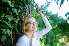 Girl keen on book keep reading. Woman blonde take break relaxing in park reading book. Lady cheerful laugh she likes. Funny stories. Bookworm student relaxing stock image