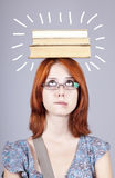 Girl keep books on her head. Royalty Free Stock Image