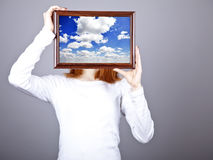 Girl keep frame with clouds sky inside. Stock Photography
