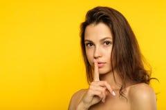 Girl keep secret mystery finger on lips gesture stock photos