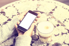 Girl keeping cell phone and coffee outdoor Stock Image