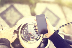Girl keeping a cell phone and motorbike, Stock Photos