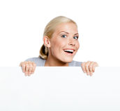 Girl keeping huge sheet of paper Royalty Free Stock Photos