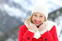 Girl keeping warm and looking at you in winter Stock Images