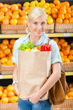 Girl keeps bag with fresh vegetables Royalty Free Stock Photo