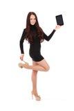 Girl keeps black tablet pc standing sideways Stock Photo