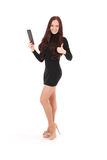 Girl keeps black tablet pc standing sideways Royalty Free Stock Photo