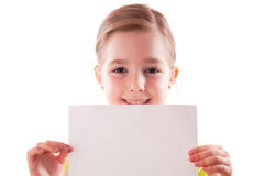 Girl keeps a blank sheet of paper Royalty Free Stock Images