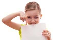 Girl keeps a blank sheet of paper Stock Image