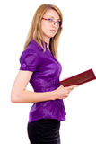 The girl keeps a book and indicates Stock Photography