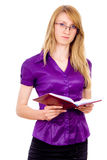 The girl keeps a book and indicates Stock Photo