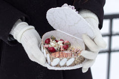 The girl keeps a casket in gloves with a beads Stock Image