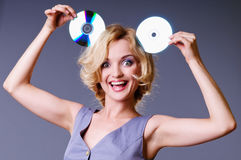 Girl keeps disks Stock Photos