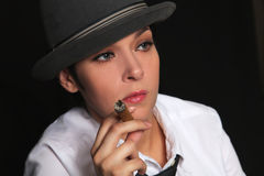 The girl keeps in fingers a cigar Stock Photography