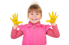 Girl keeps hands painted in yellow Royalty Free Stock Photos