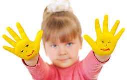 Girl keeps hands which are painted in yellow color Royalty Free Stock Photo