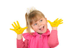 Girl keeps hands which are painted in yellow color Stock Photography