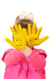 Girl keeps hands which are painted in yellow color Royalty Free Stock Photos