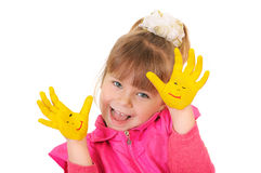 Girl keeps hands which are painted in yellow color Stock Image