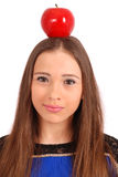 Girl keeps on head a apple Royalty Free Stock Photo