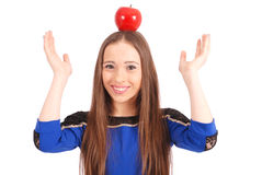 Girl keeps on head a apple Royalty Free Stock Photography