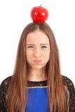 Girl keeps on head a apple Stock Photos