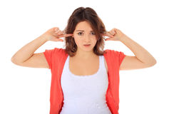 Girl keeps her ears shut Stock Photography