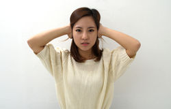Girl keeps her ears shut Royalty Free Stock Photo