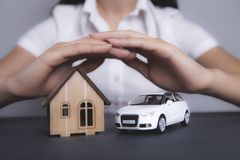 Girl keeps house and car royalty free stock photos