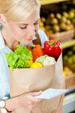 Girl keeps package with fresh vegetables Stock Photography