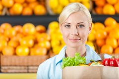 Girl keeps packet with fresh vegetables Stock Photo