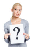 Girl keeps paper with question mark Stock Images