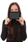 Girl keeps tablet pc the face Stock Photo