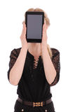 Girl keeps tablet pc the face. Isolated on white. Close-up Royalty Free Stock Photography