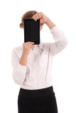 Girl keeps tablet pc the face. Isolated on white. Close-up Royalty Free Stock Photo